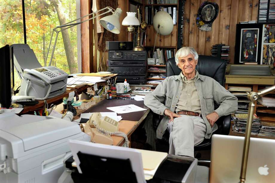 Artworks by author and artist Joseph Farris, a cartoonist for The New Yorker, are on view in a new exhibit at Byrd's Books in Bethel. Farris is shown here in his Bethel home. Photo: Carol Kaliff