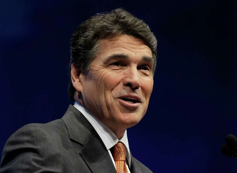 In this April 13, 2012 file photo, Texas Governor Rick Perry speaks in St. Louis. Republican governors who've balked at creating new consumer health insurance markets under President Barack Obama's health care law may end up getting stuck.  Instead of their state officials retaining some control over insurance issues that states traditionally manage, Washington could be calling the shots. Photo: Michael Conroy, Associated Press / AP