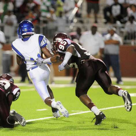 "Central defensive tackle Kewan Alfred (95) chases down Ozen running back Leroy Jackson (14) in the first half during their Beaumont Bowl crosstown rivalry at the Carol A.""Butch"" Thomas Educational Support Center. Friday, September 24, 2010 Valentino Mauricio/The Enterprise Photo: Valentino Mauricio / Beaumont"