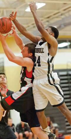 Fairfield Warde high school's Max Garrett (left) and Trumbull high school's John Watts fight for a rebound in a boys basketball game against played at Trumbull high school, Trumbull, CT on Monday December 17th, 2012. Photo: Mark Conrad / Connecticut Post Freelance