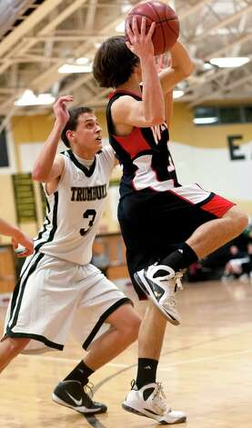 Trumbull high school's Luke Waldek tries to keep Fairfield Warde high school's Mike Pehota from moving the ball up court in a boys basketball game played at Trumbull high school, Trumbull, CT on Monday December 17th, 2012. Photo: Mark Conrad / Connecticut Post Freelance