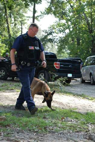 Corporal Steven Drumm and his partner, Ky, assist in a drug bust in Hardin County. Photo: Jay Cockrell