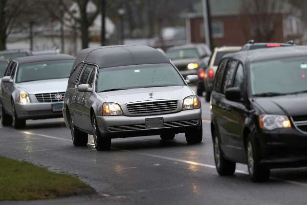NEWTOWN, CT - DECEMBER 18:  A hearse carrying the body of shooting victim James Mattioli, 6, arrives for his funeral at the St. Rose of Lima Catholic church on December 18, 2012 in Newtown, Connecticut. Funeral services were held at the church for both James Mattioli and Jessica Rekos, 6, Tuesday, four days after 20 children and six adults were killed at Sandy Hook Elementary School.  (Photo by John Moore/Getty Images) Photo: John Moore, Getty Images / 2012 Getty Images