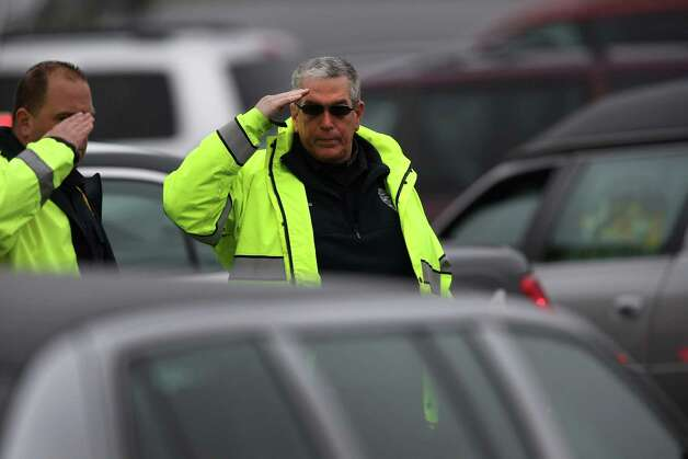 NEWTOWN, CT - DECEMBER 18:  Police salute as family members of shooting victim James Mattioli, 6, arrive for his funeral at the St. Rose of Lima Catholic church on December 18, 2012 in Newtown, Connecticut. Funeral services were held at the church for both James Mattioli and Jessica Rekos, 6, Tuesday, four days after 20 children and six adults were killed at Sandy Hook Elementary School.  (Photo by John Moore/Getty Images) Photo: John Moore, Getty Images / 2012 Getty Images