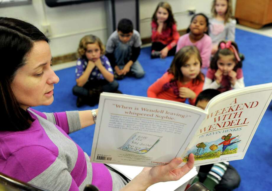 "First-grade teacher Caroline Sarlo reads ""A Weekend With Wendell"" to her Academic Enrichment class at Springdale Elementary School on Tuesday, December 18, 2012. Photo: Lindsay Niegelberg, Niegelberg / Stamford Advocate"