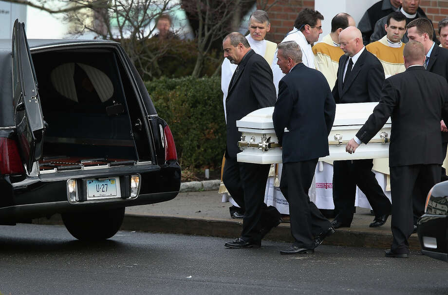 NEWTOWN, CT - DECEMBER 18:  A casket carrying the body of shooting victim Jessica Rekos, 6, is brought out after her funeral at the St. Rose of Lima Catholic church on December 18, 2012 in Newtown, Connecticut. Funeral services were held at the church for both Jessica and James Mattioli, 6, Tuesday, four days after 20 children and six adults were killed at Sandy Hook Elementary School. Photo: John Moore, Getty Images / 2012 Getty Images