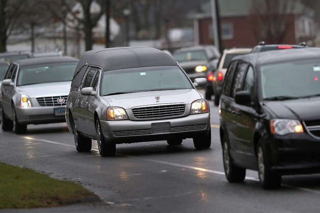 NEWTOWN, CT - DECEMBER 18:  A hearse carrying the body of shooting victim James Mattioli, 6, arrives for his funeral at the St. Rose of Lima Catholic church on December 18, 2012 in Newtown, Connecticut. Funeral services were held at the church for both James Mattioli and Jessica Rekos, 6, Tuesday, four days after 20 children and six adults were killed at Sandy Hook Elementary School. Photo: John Moore, Getty Images / 2012 Getty Images