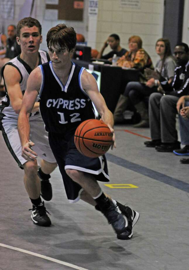 Cypress Christian senior Cody Chaffin (12) drove to the basket strongly during the Cypress Christian Tournament earlier this month. Photo: L. Scott Hainline, Freelance / Freelance
