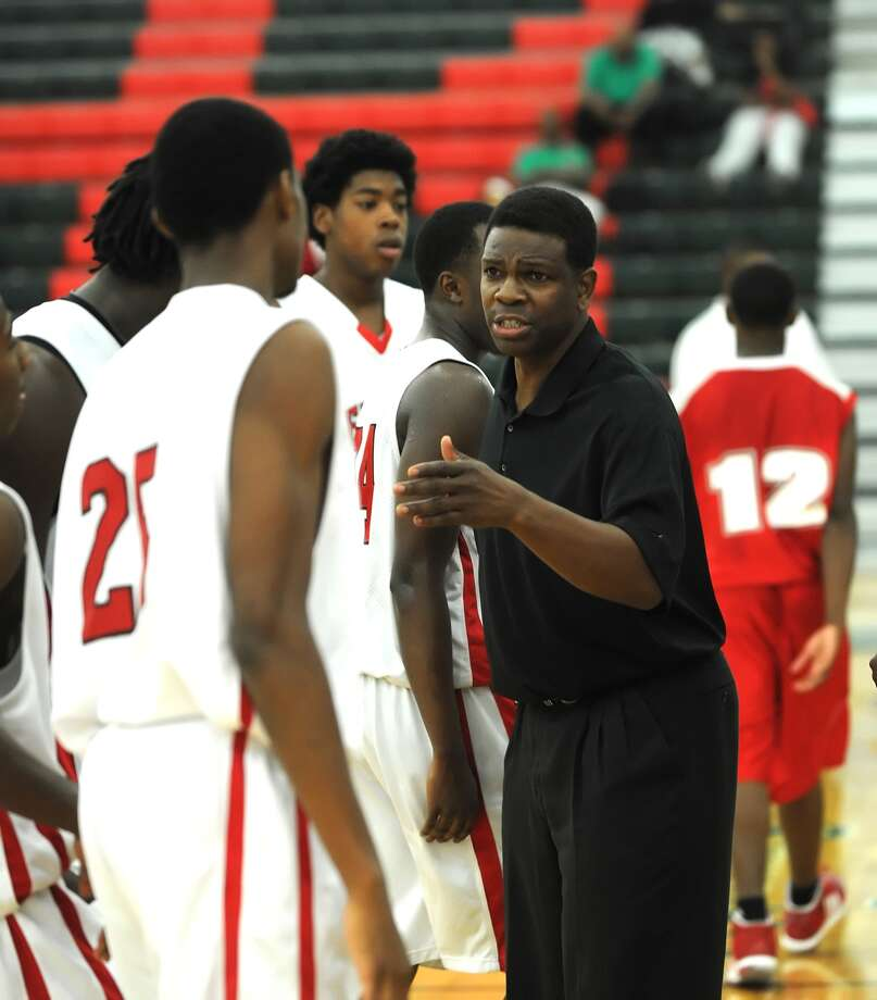 Bellaire boys varsity basketball team participated in the 9th Annual Texas High School Jamboree held at Strait Jesuit High School.  Coach Bruce Glover talks to team during a time out.    Photo Eddy Matchette Photo: Eddy Matchette, Freelance / freelance