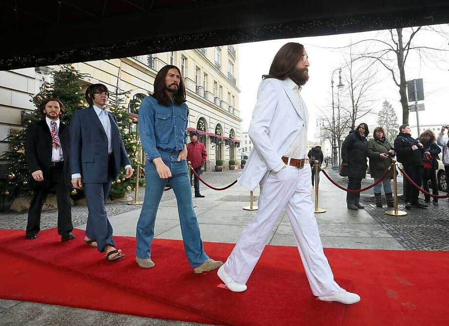 Abbey Road milestone: Wax figures of John (right), George, Paul and Ringo stand in mid-cover art stride at the entrance to the Adlon Hotel in Berlin. More than 50 years ago, on June 6, 1962, the Beatles recorded their first songs for EMI Studios at 3 Abbey Road, St. John's Wood, London. Photo: Stephanie Pilick, AFP/Getty Images