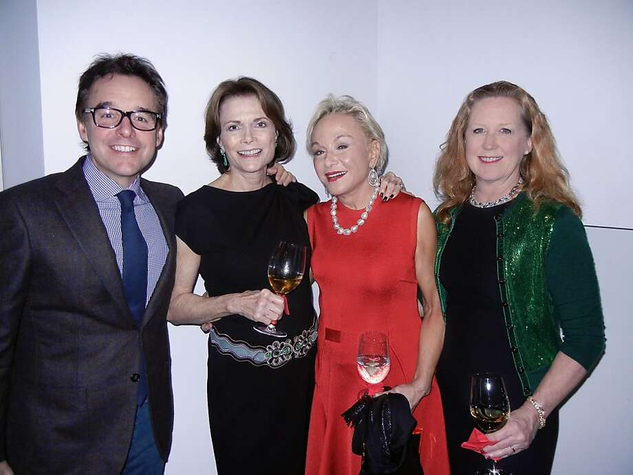 Director Christopher Columbus (left), Kay Walker, Sandra Smith and Columbus' wife, Monica Devereux, at the Walkers' Christmas party. Photo: Catherine Bigelow, Special To The Chronicle