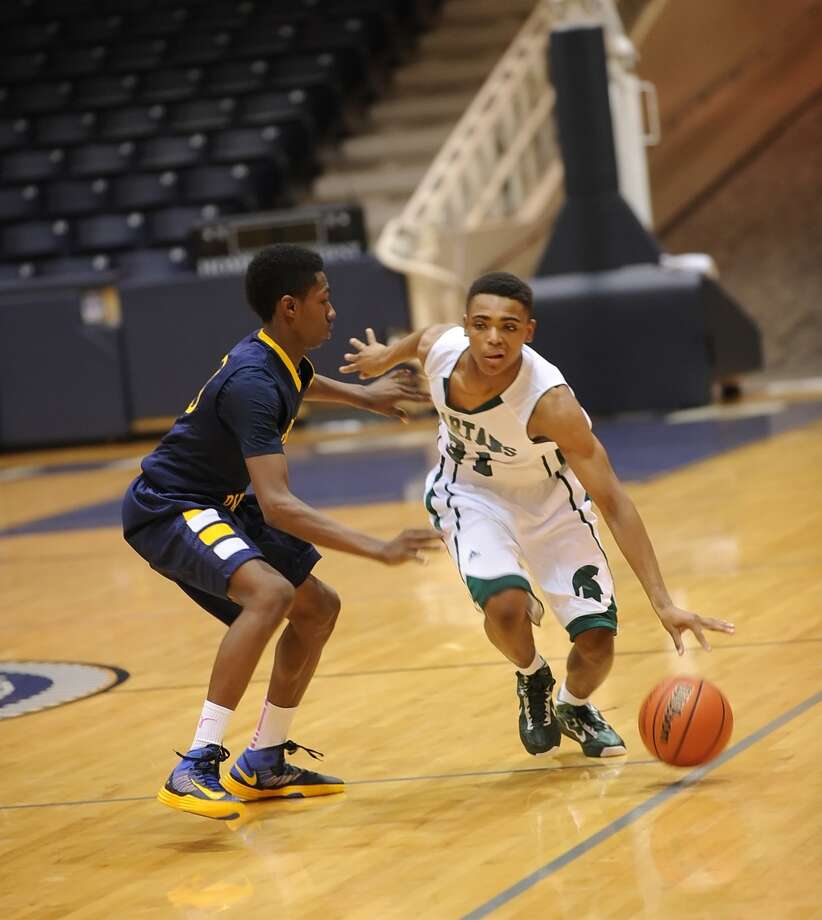Cy Ranch And Stratford boys basketball teams met at Coleman Coliseum, 12-14-12.  Stratford won the game, 62-50.   Right, Stratford's Joseph Stubblefield (31) gets defensive pressure from Cy Ranch guard Carl Garcia (10). Photo: Eddy Matchette, Freelance / Freelance