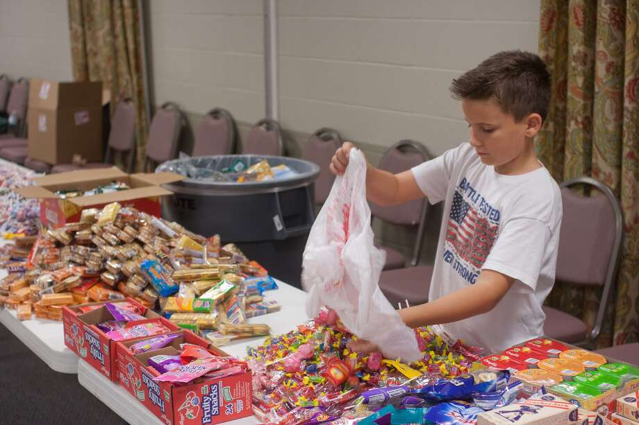 Jackson Munsey prepares boxes to be sent to the troops from Sugar Creek Baptist Church in Sugar Land.Jackson Munsey prepares boxes to be sent to the troops from Sugar Creek Baptist Church in Sugar Land.Jackson Munsey prepares boxes to be sent to the troops from Sugar Creek Baptist Church in Sugar Land. Photo: R. Clayton McKee, Freelance / © R. Clayton McKee