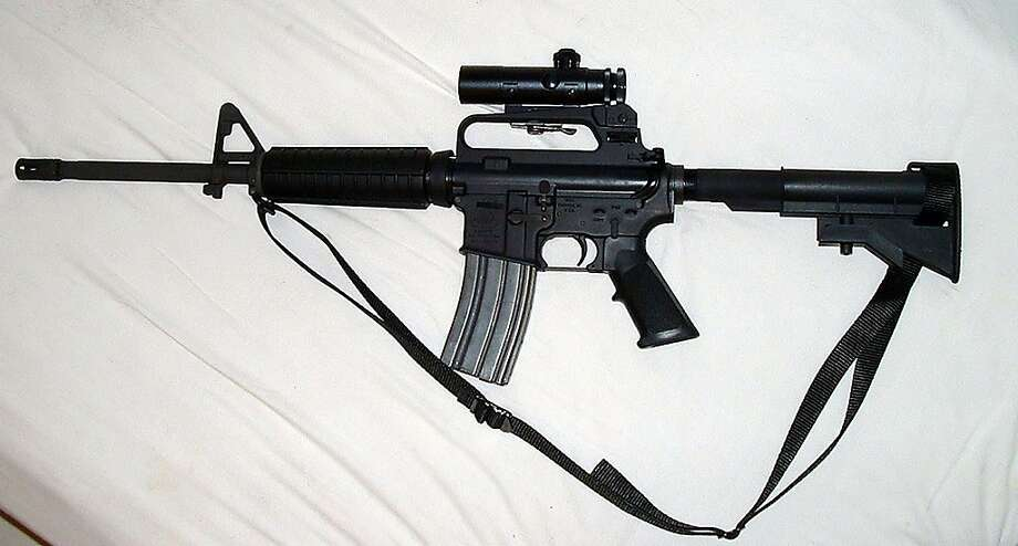 A photo of an actual Bushmaster Carbine with a 16 inch barrel. It can take twenty and thirty round mags and is toped with a 4 power scope and can hit an orange at 300 meters. The gun seized from two suspects in the Washington-area sniper shootings is a Bushmaster XM-15 M4 A3, a civilian version of the standard American military rifle, the M-16, according to officials of its manufacturer, Bushmaster Firearms. Bushmaster Firearms is a small privately owned company in Windham, Maine., that specializes in making copies of the M-16. (Kevin Wilson/The Ledger, Lakeland Fla.) Photo: Kevin Wilson, NYT