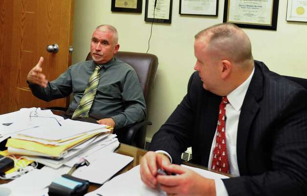 Shelton Police Detective Ben Trabka and Captain Michael Madden, right, talk about the cold case involving the shooting death of Francis Gallo 20 years ago, at a meeting to update his widow Linda, at Shelton Police Department in Shelton, Conn. on Thursday December 13, 2012. Photo: Christian Abraham / Connecticut Post