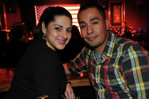 Irene Garza and Robert Galvan are enjoying a night at the Martini club.