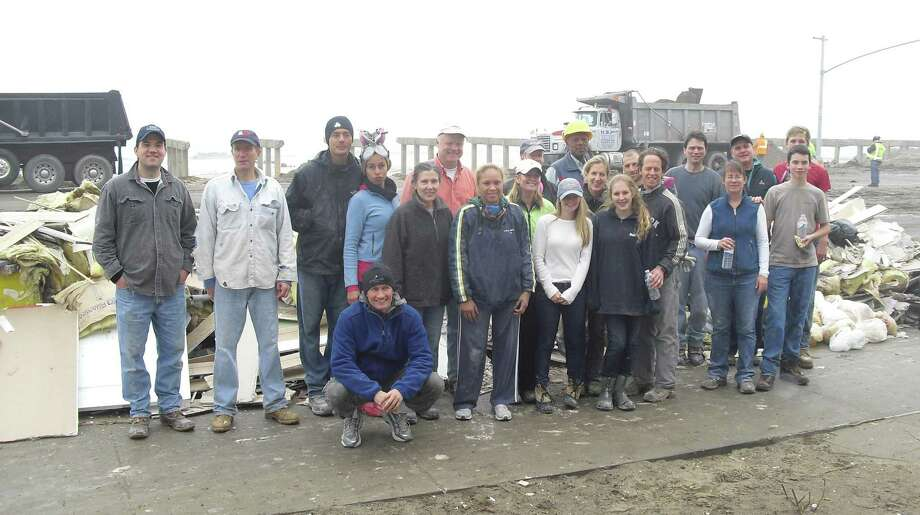 The First Presbyterian Church of New Canaan led a group of more than 20 volunteers to Far Rockaway, Queens, N.Y., Dec. 8 to help with the clean-up from Hurricane Sandy. Photo: Contributed Photo
