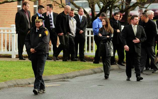 Bridgeport Police Chief Joseph Gaudett attends the funeral for Jessica Rekos, one of 20 children killed in a mass shooting at Sandy Hook Elementary School Friday morning, Tuesday, Dec. 18, 2012 at St. Rose of Lima Roman Catholic Church in Newtown, Conn. Photo: Autumn Driscoll / Connecticut Post