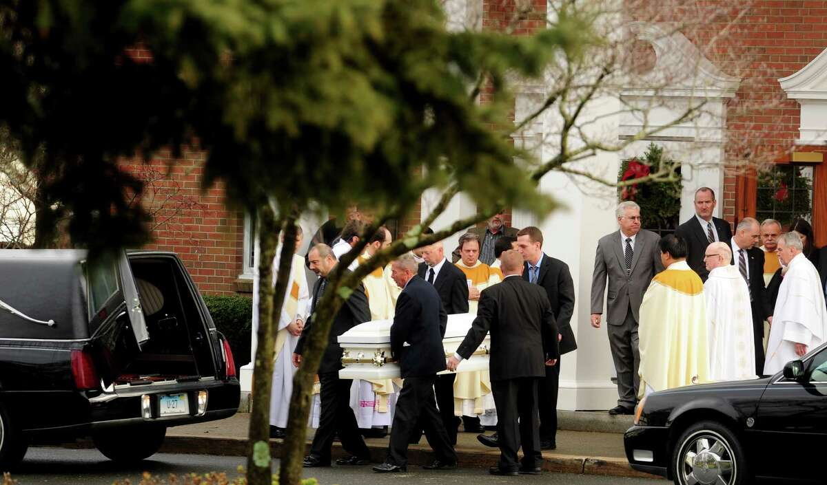 Funeral services for Jessica Rekos, one of 20 children killed in a mass shooting at Sandy Hook Elementary School Friday morning, are held Tuesday, Dec. 18, 2012 at St. Rose of Lima Roman Catholic Church in Newtown, Conn.