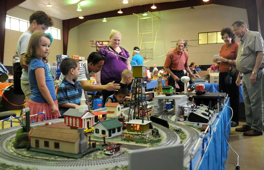 Fiona Lacey, 7, left, checks out the kids interactive display during the Train Collectors Association Gulf Coast Chapter's annual show at Cypress Creek Christian Community Center.  in Spring. Freelance photo by Jerry Baker Photo: Jerry Baker, Freelance