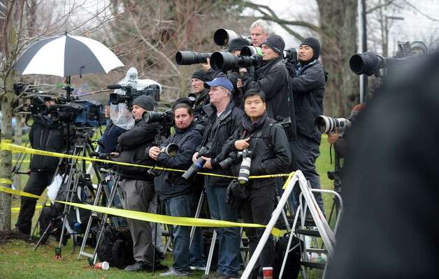 Media at funeral services for Jessica Rekos, one of 20 children killed in a mass shooting at Sandy Hook Elementary School Friday morning, Tuesday, Dec. 18, 2012 at St. Rose of Lima Roman Catholic Church in Newtown, Conn. Photo: Autumn Driscoll / Connecticut Post