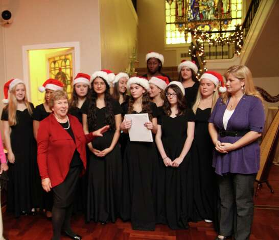 "Convent of the Sacred Heartís Madrigals singing group will sing ""Carol of the Bells"" live on NBCís ìTodayî show at 9 a.m. Thursday, Dec. 20, 2012, outside NBC Studios at 30 Rockefeller Plaza in New York City. The performance will be broadcast around the country. Pictured here Dec. 8, Jayne Collins, left in red, the head of the Upper School at Convent of the Sacred Heart, announces that the madrigals, wearing black, would perform on the show. At right is Music Director Annette Etheridge. Photo: Contributed Photo"