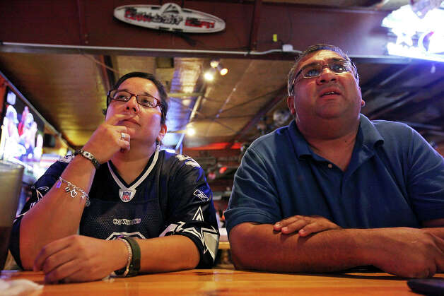 Dallas Cowboys fans Anna Cavazos, 45, (left) and Paul Resendez, 46, watch the Cowboys and Philadelphia Eagles game Sunday Dec. 2, 2012 at Fatso's Sports Garden. The Cowboys won the game 38-33. Photo: Edward A. Ornelas, San Antonio Express-News / © 2012 San Antonio Express-News