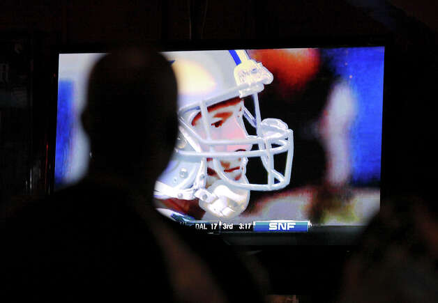 A Dallas fan watches a big-screen broadcast of the game against the Philadelphia Eagles at Fatso's Sports Garden. The Cowboys won the game 38-33. Photo: Edward A. Ornelas, San Antonio Express-News / © 2012 San Antonio Express-News