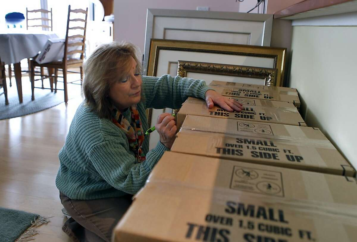 Shirley Ann Stern labels boxes before moving from her condo in San Francisco, Calif. on Friday, Dec. 14, 2012. Stern just purchased a new home near the UCSF Mission Bay campus. Congress may curtail the mortgage-interest tax deduction which, she says, would make life a lot harder financially.