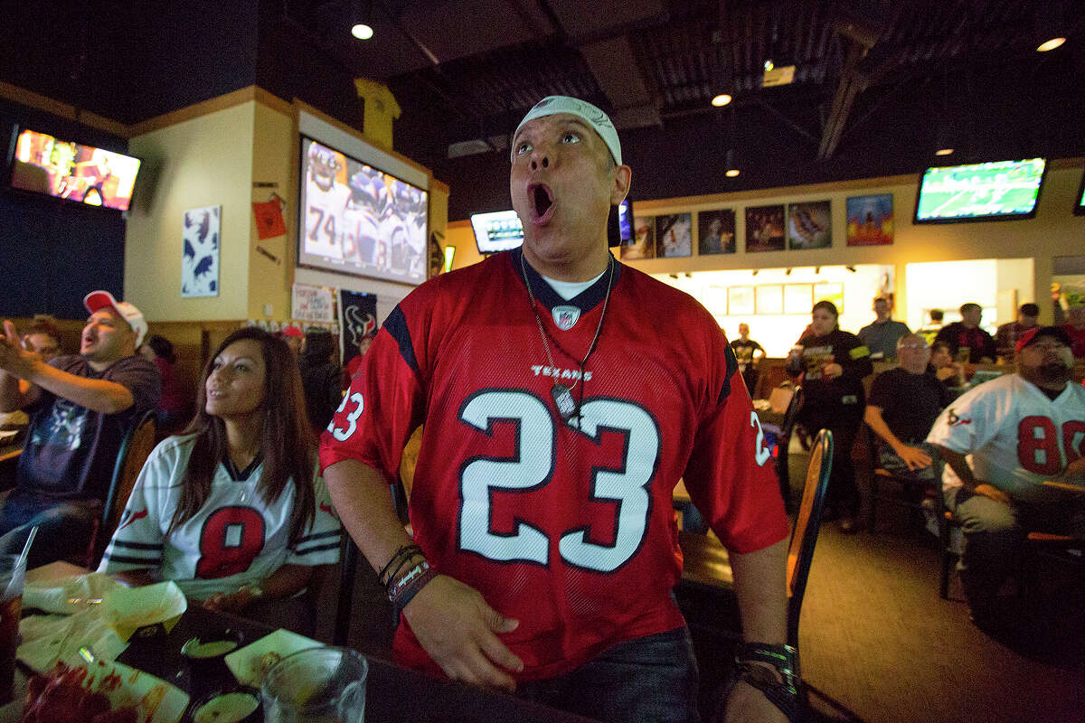 Oved Carranza of the Houston Texans Fan Club of San Antonio cheers after a big play during a Texans game against the Tennessee Titans.