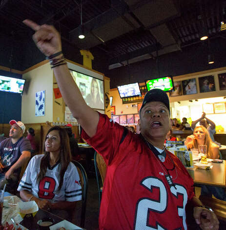 Oved Carranza of the Houston Texans Fan Club of San Antonio questions a call made by officials during a Texans game against the Tennessee Titans at Buffalo Wild Wings Grill & Bar at 5860 De Zavala Road on Sunday, Dec. 2, 2012. Carranza has been a fan since the Texans started in 2002. Photo: Michael Miller, For The Express-News / © San Antonio Express-News