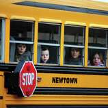 Children leave Hawley School Tuesday, Dec. 18, 2012 following their first day back at school since Friday's mass shooting in Newtown, Conn.