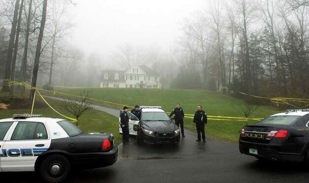 Stamford and Westport police outside the home of Nancy Lanza  December 18, 2012 in Newtown, Connecticut.  Nancy Lanza was killed by her son Adam before going on his rampage at Sandy Hook Elementary School on December 14, 2012. AFP PHOTO/DON EMMERT        (Photo credit should read DON EMMERT/AFP/Getty Images) Photo: DON EMMERT, AFP/Getty Images / 2012 AFP