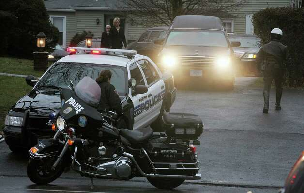 NEWTOWN, CT - DECEMBER 17:  The hearse carrying the body of 6-year-old Jack Pinto departs Honan Funeral Home following his funeral on December 17, 2012 in Newtown, Connecticut escorted by police from departments throughout Fairfield County. Pinto was one of the 20 students killed in the Sandy Hook Elementary School mass shooting.  (Photo by Mario Tama/Getty Images) Photo: Mario Tama, Getty Images / 2012 Getty Images