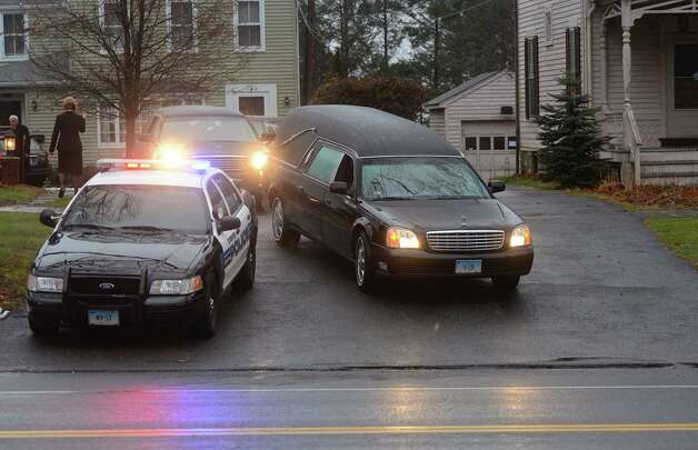 NEWTOWN, CT - DECEMBER 17:  The hearse carrying the body of 6-year-old Jack Pinto departs Honan Funeral Home following his funeral on December 17, 2012 in Newtown, Connecticut escorted by police from departments throughout Fairfield County. Pinto was one of the 20 students killed in the Sandy Hook Elementary School mass shooting.  (Photo by Mario Tama/Getty Images) Photo: EMMANUEL DUNAND, AFP/Getty Images / 2012 AFP