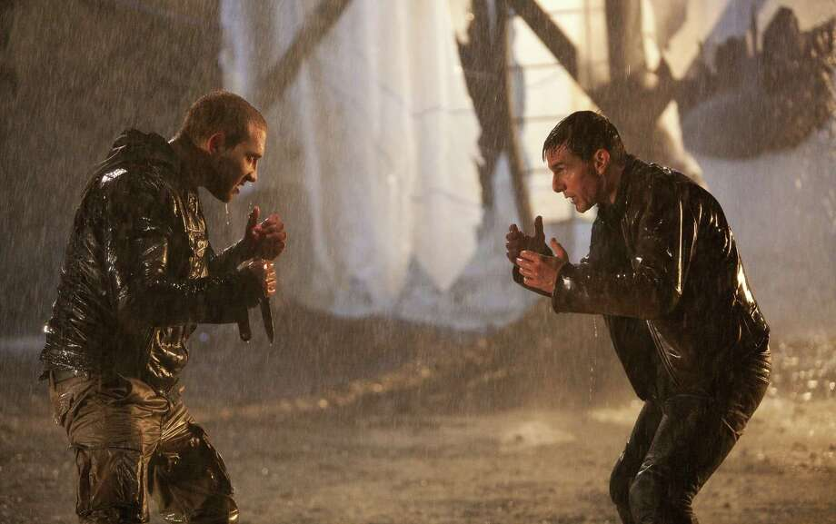 "This undated publicity photo released by Paramount Pictures shows Tom Cruise, right, as Reacher and Jai Courtney as Charlie in the film, ""Jack Reacher."" (AP Photo/Paramount Pictures, Karen Ballard) Photo: Karen Ballard, Associated Press / Paramount Pictures"
