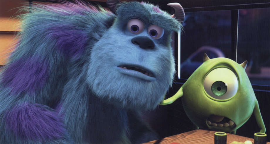 Sulley (left, voiced by John Goodman) and his Scare Assistant, Mike Wazowski (right, voiced by Billy Crystal) are wide-eyed at how much trouble is caused when Boo gets loose in 'Monsters, Inc.' Photo: DISNEY/PIXAR / 2001 DISNEY/PIXAR. ALL RIGHTS RESERVED