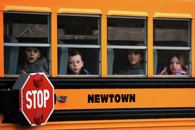Hawley Elementary School students leave on a school bus following school on Dec. 18th, 2012, in Newtown, Conn. Tuesday was the first day that students in Newtown went back to class following the mass shooting at Sandy Hook Elementary School last Friday. Photo: Ned Gerard / Connecticut Post