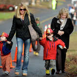 Zachary, 2, and Nathan, 4, Johnston, of Easton, wear the new fire helmets they received from firefighters at Sandy Hook Volunteer Fire Department, in Newtown, Conn. Dec. 18th, 2012. The boys, seen here with their mother, Joelle Johnston, and neighbor Carolette Johnson, visited the Sandy Hook firehouse Tuesday to delivers a gift to first responders.