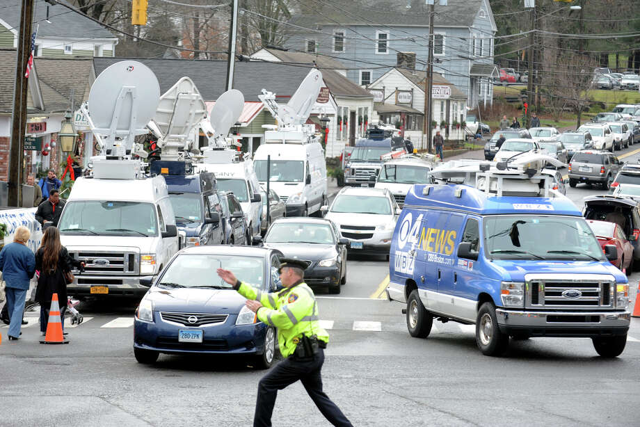 Traffic continues to choke the main intersection at Sandy Hook, in Newtown, Conn., Dec. 18th, 2012. Traffic in Sandy Hook and Newtown continues to grow following last Friday's mass shooting at Sandy Hook Elementary School. Photo: Ned Gerard / Connecticut Post