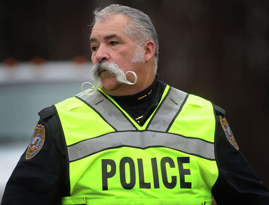 A Meriden police officer provides security outside the funeral of James R. Mattioli, one of the children killed in the Sandy Hook Elementary School shootings, at St. Rose of Lima Catholic Church in Newtown on Tuesday, December 18, 2012. Photo: Brian A. Pounds / Connecticut Post
