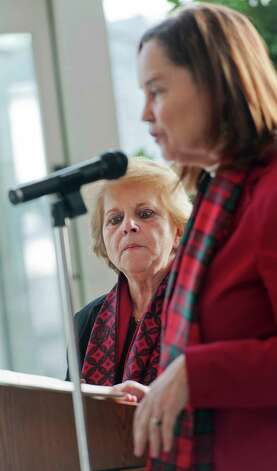 "Lucy Corelli, Stamford CT republican registrar of voters (left) listens as Denise Merrill, Connecticut Secretary of the State, presents the ""Democracy Cup"" to  Lucy and Alice Fortunato, Stamford CT democratic registrar of voters. The Democracy Cup was awarded to Stamford because Stamford had the highest percentage of voter turnout for a large city on this years election day.The ceremony was held in the lobby of the Government Center, Stamford, CT on Tuesday December 18th, 2012 Photo: Mark Conrad / Stamford Advocate Freelance"