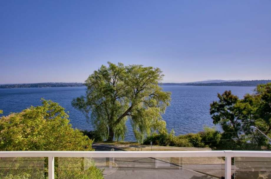 View from 519 Lake Washington Boulevard. The 2,490-square-foot house, built in 1902, has three bedrooms, three bathrooms, a lower-level apartment with a second kitchen, second master suite and family/media room, multiple decks and a two-car garage on a 6,480-square-foot lot. It's listed for $1.195 million. Photo: Courtesy Kathryn Hinds And Margie Zech/Windermere Real Estate