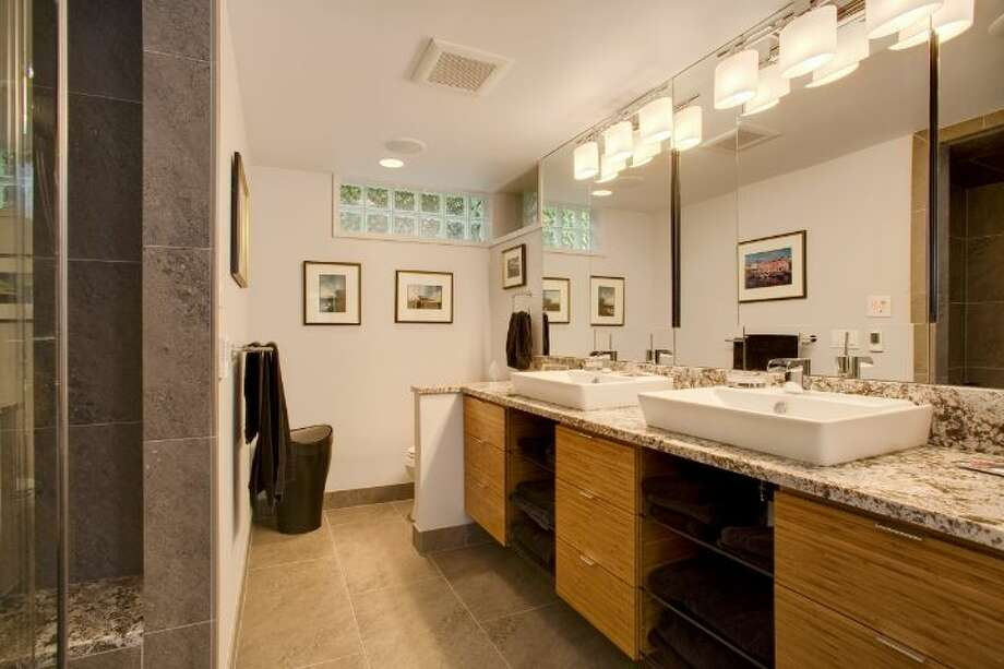 Lower-level master bathroom of 519 Lake Washington Boulevard. The 2,490-square-foot house, built in 1902, has three bedrooms, three bathrooms, a lower-level apartment with a second kitchen and family/media room, multiple decks and a two-car garage on a 6,480-square-foot lot. It's listed for $1.195 million. Photo: Courtesy Kathryn Hinds And Margie Zech/Windermere Real Estate