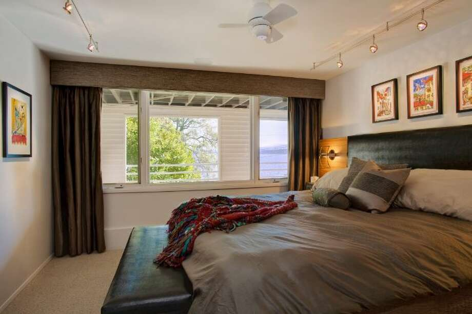 Lower-level master bedroom of 519 Lake Washington Boulevard. The 2,490-square-foot house, built in 1902, has three bedrooms, three bathrooms, a lower-level apartment with a second kitchen and family/media room, multiple decks and a two-car garage on a 6,480-square-foot lot. It's listed for $1.195 million. Photo: Courtesy Kathryn Hinds And Margie Zech/Windermere Real Estate