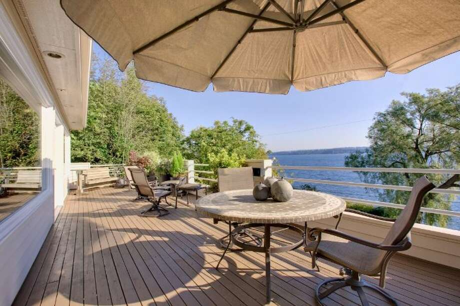 Deck of 519 Lake Washington Boulevard. The 2,490-square-foot house, built in 1902, has three bedrooms, three bathrooms, a lower-level apartment with a second kitchen, second master suite and family/media room, multiple decks and a two-car garage on a 6,480-square-foot lot. It's listed for $1.195 million. Photo: Courtesy Kathryn Hinds And Margie Zech/Windermere Real Estate