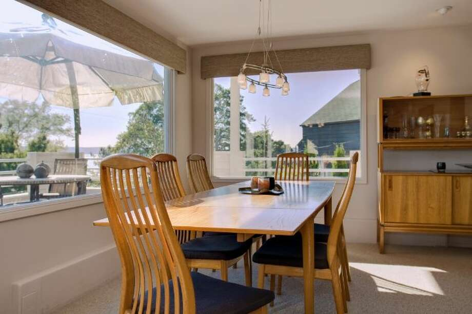 Dining room of 519 Lake Washington Boulevard. The 2,490-square-foot house, built in 1902, has three bedrooms, three bathrooms, a lower-level apartment with a second kitchen, second master suite and family/media room, multiple decks and a two-car garage on a 6,480-square-foot lot. It's listed for $1.195 million. Photo: Courtesy Kathryn Hinds And Margie Zech/Windermere Real Estate