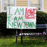 This sign in front of a house on Main Street in Newtown, is one of many memorials in honor of the 26 victims of the Sandy Hook Elementary School shooting last Friday.
