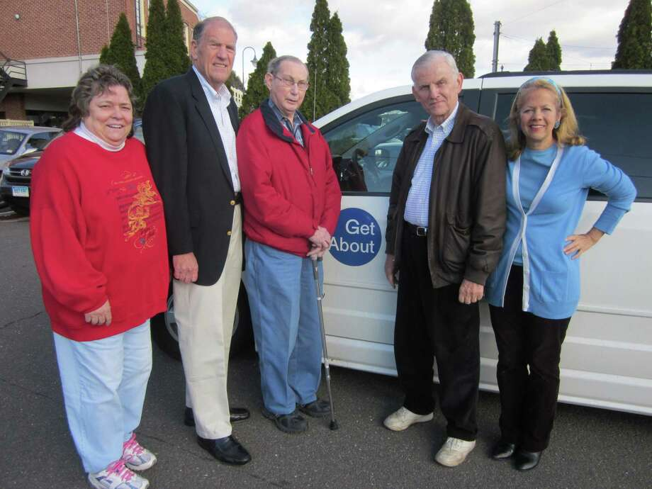 Ray Guthke, a long-dispatcher for Getabout, is retiring. From left, new dispatcher Judy Fuegner, Getabout board member Harvey Place, Guthke, retiring driver Rod Aspinwall and board member Beth Reifers. Photo: Contributed Photo