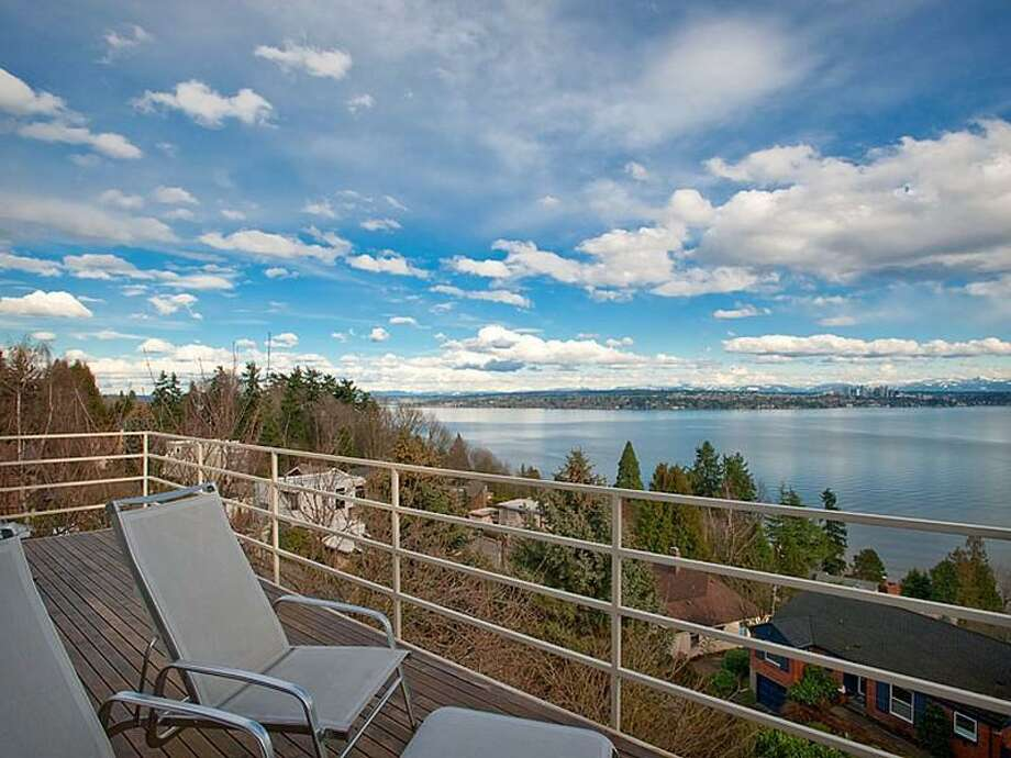 Deck of 700 37th Ave. The 2,220-square-foot house, built in 1977, has two bedrooms, two three-quarter bathrooms, a lower-level rec room, walls of windows, a skylight, built-ins and unobstructable views of Lake Washington, Bellevue and the Cascade Mountains. It's listed for $995,000. Photo: Courtesy Moira Holley And Scott Wasner/Realogics Sotheby's International Realty